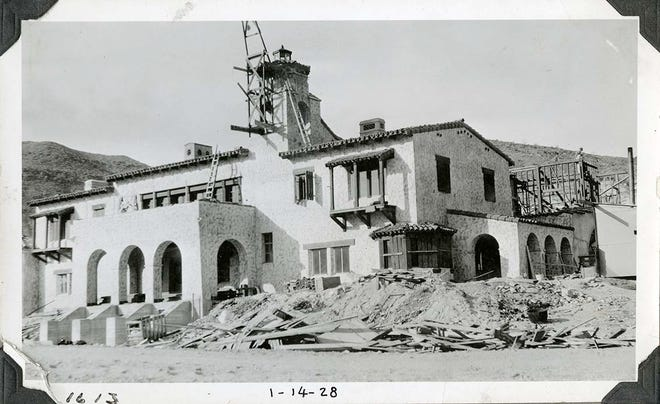 Scotty's Castle during the second phase of construction, January 1928. Construction appears focused on the annex wing, behind the main house.