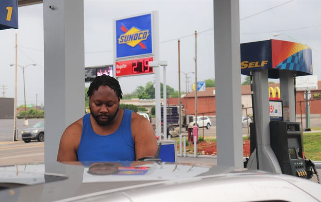 Ron Harper, 40, fills up his Cadillac at the Sunoco gas station west of downtown Canton on Wednesday. AAA is predicting high gas prices this summer.