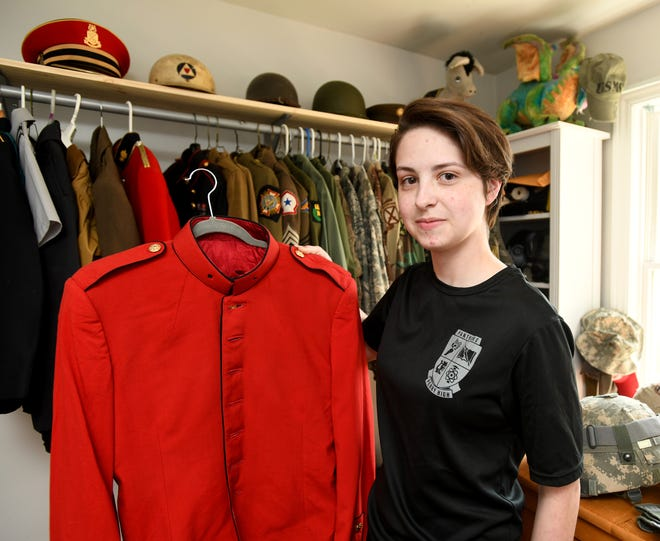 Deven Huwig, 16, a Perry High School junior and ROTC member, has a military memorabilia collection that totals nearly 200 items. She began collecting around age 11, when playing military war video games seemed to spark her interest in the military.