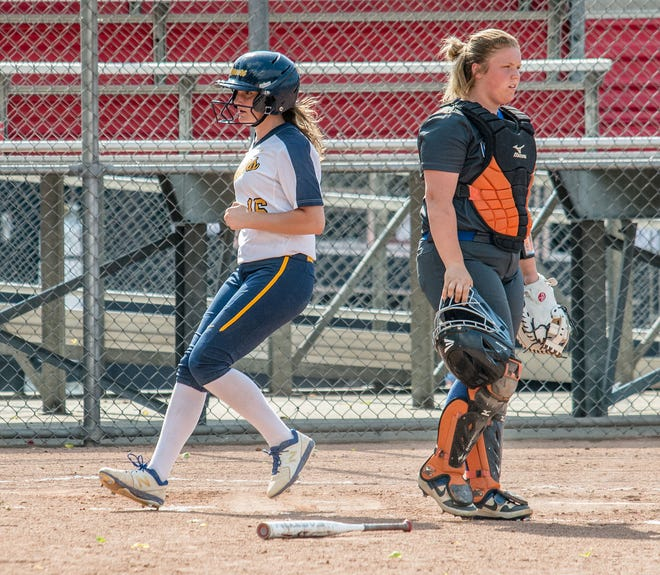 Mooresville pinch-runner Maddie Gainey crosses home plate on a double to right field by senior Alexis Nelson during the sectional game against Whiteland on Tuesday, May 25, 2021. (Eric Scott Miller / Correspondent)