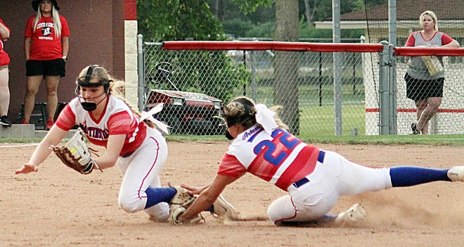 Martinsville sophomore Holly Galyan dives for a short pop fly. Senior second baseman Macey Staley also went for the ball but held off when Galyan called her off for the out during Tuesday's IHSAA Sectional semi-final game against Center Grove. (Melissa Dillon/Correspondent)