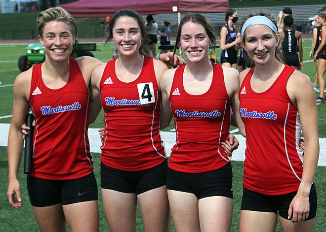 They're back! Members of Martinsville's 4x400-meter relay team are again all smiles after winning Tuesday's Bloomington North regional. They are (from left): Morgan Schrock, Hanna Reuter, Holli Reuter and Alina Worzella. (Steve Page / Correspondent)