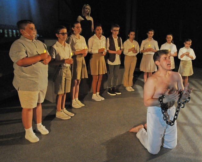 Ethan Badders, as Joseph, acts out a scene of being locked in jail in the musical Joseph and the Amazing Technicolor Dreamcoat that will being at the Salina Community Theatre starting Friday, June 4.