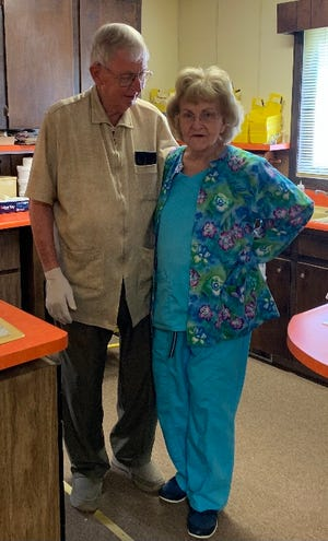 Gerald and Frances Lutz pose for a photo inside their dentist office in Fallston.