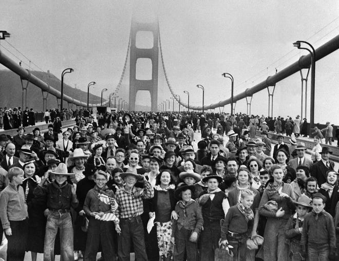 Thousands hike across the Golden Gate Bridge in San Francisco on May 27. 1937, after it was opened to pedestrians for a preview before opening to vehicles.