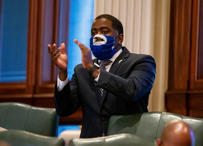Illinois State Rep. Marcus Evans, Jr., D-Chicago, celebrates passage of SJRCA 11, a ballot question for a constitutional amendment protecting the right to unionize, on the floor of the Illinois House of Representatives at the Illinois State Capitol in Springfield, Ill., Wednesday, May 26, 2021.