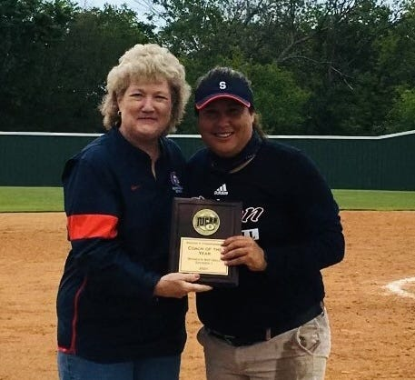 Seminole State College President Lana Reynolds congratulates SSC Head Softball Coach Amber Flores after she is named NJCAA Region II Coach of the Year at the regional tournament in Muskogee on May 16.