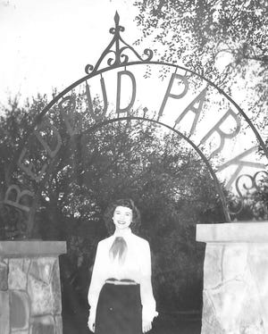 Barbara Bell poses for this photo in 1942 at the entrance to the new Redbud Park on north Broadway Street.