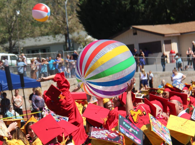 Long before COVID-19 was heard of, Yreka High School graduates celebrated with beach balls during their 2016 graduation ceremony.