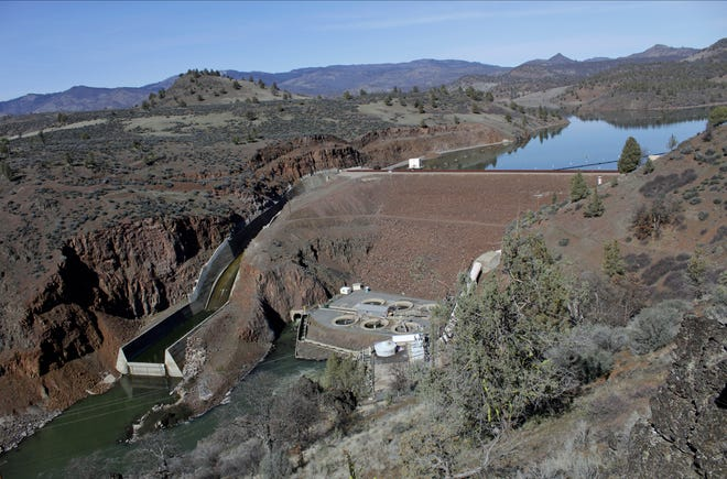 FILE - In this March 3, 2020, file photo, is the Iron Gate Dam, powerhouse and spillway are on the lower Klamath River near Hornbrook, Calif. Two farmers with ties to anti-government activist Ammon Bundy have purchased land by a shut-off irrigation canal in Oregon that would normally deliver water to a massive federal irrigation project along the California-Oregon border, Jefferson Public Radio reports. (AP Photo/Gillian Flaccus, File)