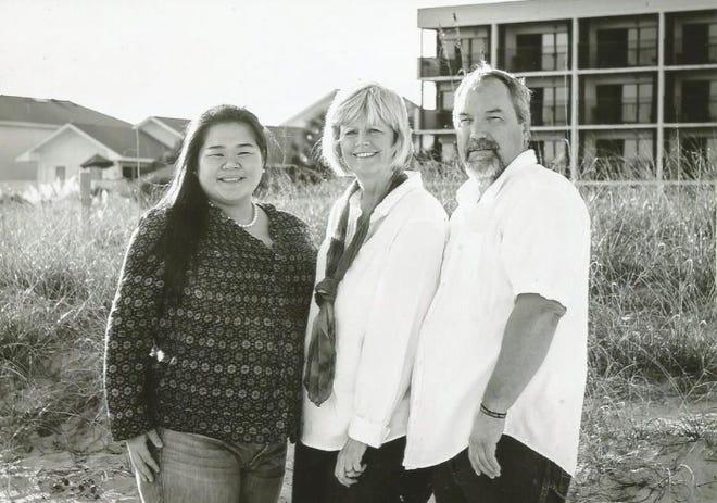 Alyssa Lee Van Bourgondien with her parents, Susan Donovan and Robert Burrows.