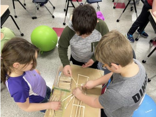 Elementary students work with a STEM kit, which is a program from Northern State University.