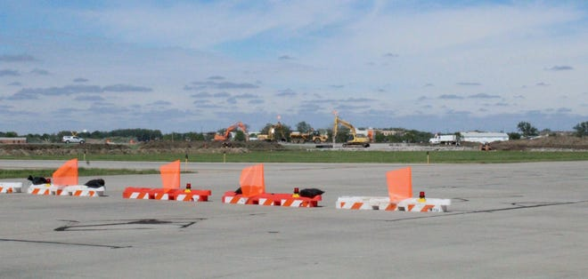 Contractors for Sharpe Enterprises in Fort Pierre remove concrete from the end of Runway 13-31 as part of a $5 million taxiway geometry project at the Aberdeen Regional Airport.