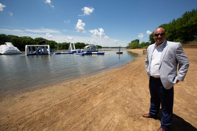 Shawnee County commissioner Aaron Mays remembers childhood times he would swim at the Lake Shawnee swim beach before it became the Adventure Cove in 2016.