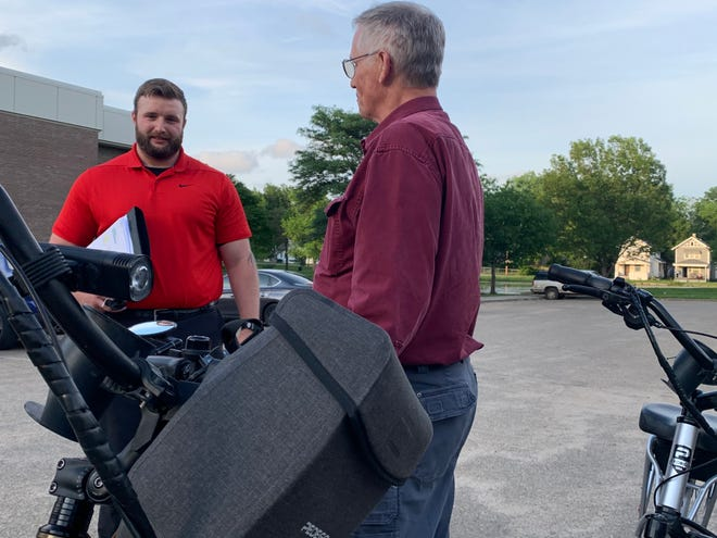 Derik Flerlage, left, and Chuck Towle look at some electric bikes after a Shawnee County Parks and Recreation Advisory Board meeting.