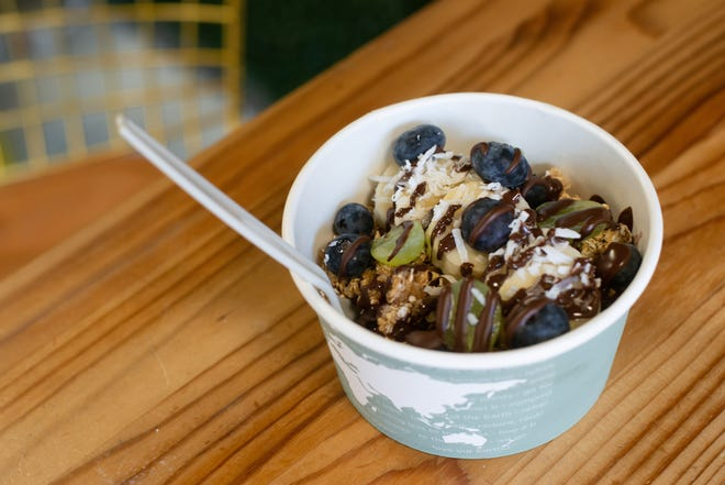 Onyx Wellness Cafe's açaí bowl with a chocolate drizzle is a cool treat for $9.73.