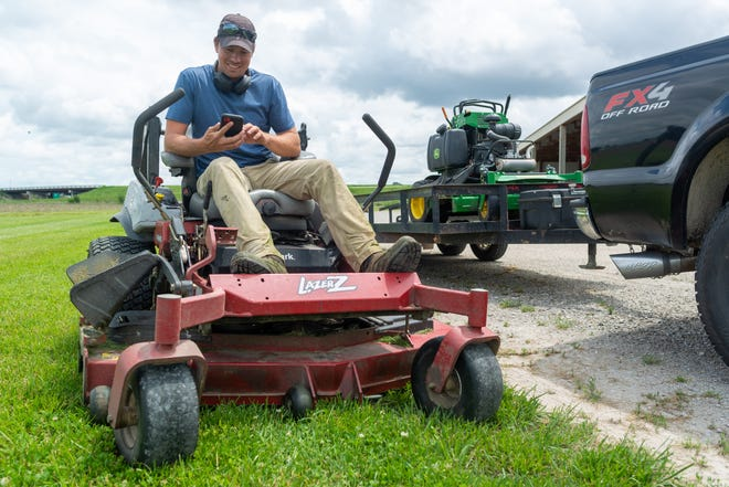 GreenPal, an app designed to connect homeowners with vetted lawn-care professionals, expanded to Topeka this month. James Sage, owner of Sage Lawn & Landscape, pictured here, has already signed on.