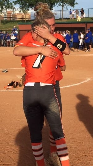 Trenton High sisters Darian and Adrian Ingram share a hug after the Tigers won the state title last week.