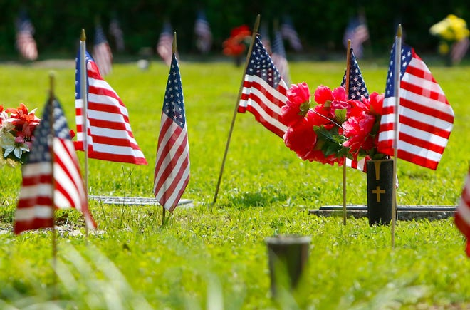 Flags are shown around veterans graves during the annual Memorial Day ceremony held at the Veteran's Memorial at Forest Meadows Cemetery East in Gainesville.