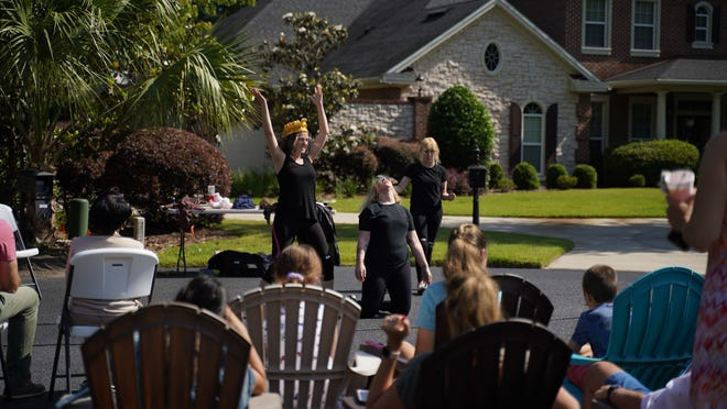 """Actors with the University of Florida Performing Arts Driveway Theatre Project perform """"The Complete Works of William Shakespeare (abridged)"""" for audience members outdoors in a Gainesville neighborhood. (Photo by James Sullivan, courtesy of Derek Wohlust)"""