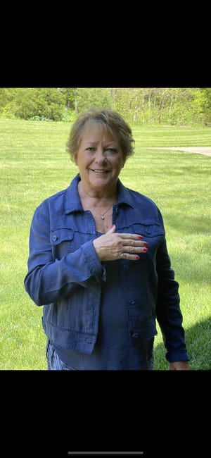 Suzi Lawyer of Bedford wears her Bedford High School class ring on her pinkie finger. The ring was stolen 50 years ago when she lived in Indianapolis.