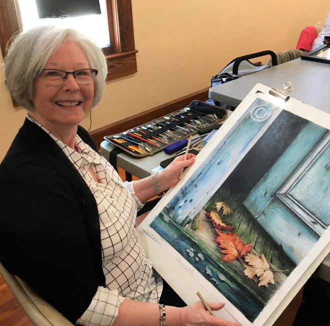 Artist Pat Hutton is shown with one of her colored pencil drawings at a recent Wiley House drawing class.