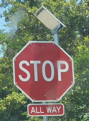 Stop! Lighted Stop sign a reminder for inattentive motorists.