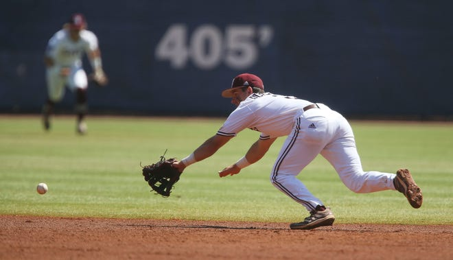 Mississippi State second baseman Scotty Dubrule dives for but can't make the play on a ground ball as he plays against Florida during the SEC Tournament Tuesday, May 26, 2021, in the Hoover Met in Hoover, Alabama. [Staff Photo/Gary Cosby Jr.]
