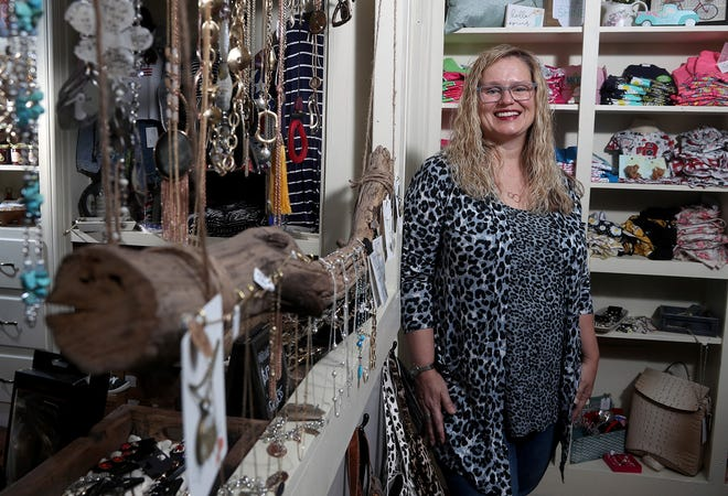 Grove City resident Valerie Heiby, pictured May 25, has opened Grove Sheek Boutique, a store offering fashion, home decor, jewelry, gifts, skin-care products and specialty foods and coffee, at 3937 Broadway in Grove City's Town Center.