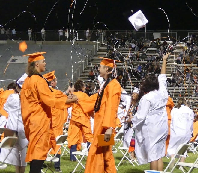 Apple Valley High School seniors celebrate during their graduation ceremony Tuesday night, May 25, 2021, at Newton T. Bass Stadium in Apple Valley.