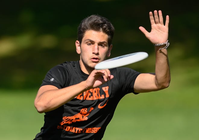 Co-captain Justin Cahill of Beverly bats down a throw during an Ultimate Frisbee game versus Winchester at Leonard Field in Winchester on Tuesday, May 25.