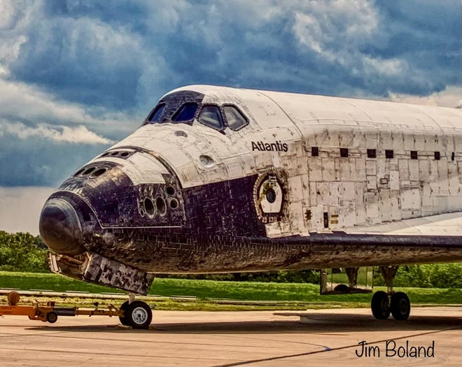 """A worn-out Atlantis returns home for the last time in Jim Boland's image of the Space Shuttle Program's last flight a decade ago. The photographer's work is part of """"Spotlight on Space,"""" a space-themed art exhibit this month at Downtown Art Gallery in Titusville."""