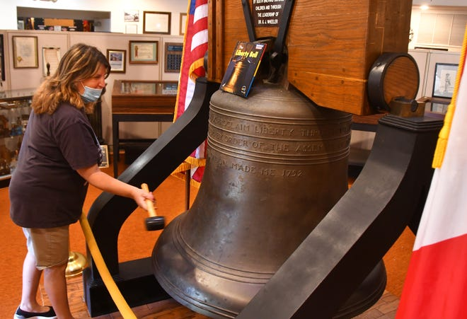 Carolyn Sabinksy, who was visiting the museum with her family, rings the bell with a rubber mallet. The Liberty Bell Museum is gearing up for a big Memorial Day celebration on Monday.