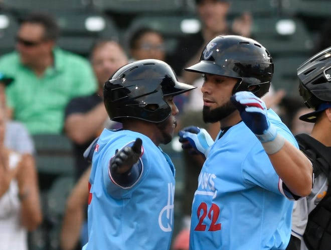 Hooks players Pedro Leon, left, and Norel Gonzalez celebrate against the Amarillo Sod Poodles, Tuesday, May 25, 2021, at Whataburger Field. Hooks won, 17-4.