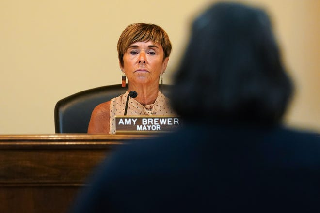 """Lebanon Mayor Amy Brewer listens to a speaker as Lebanon city council considers voting on a proposed ordinance which would declare the city of 20,000 in Warren County, north of Cincinnati, a """"sanctuary city for the unborn,"""" Tuesday, May 25, 2021, in Lebanon, Ohio."""