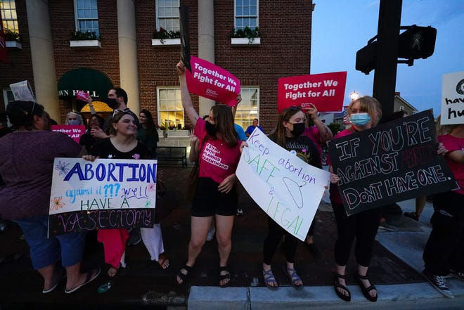 """Pro-choice protesters gather outside Lebanon town hall as city council considers voting on a proposed ordinance which would declare the city of 20,000 in Warren County, north of Cincinnati, a """"sanctuary city for the unborn,"""" Tuesday, May 25, 2021, in Lebanon, Ohio."""