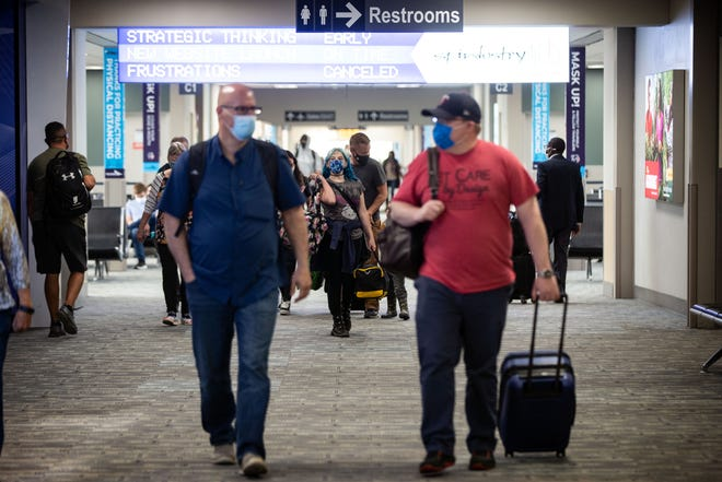 Passengers move though the Des Moines International Airport Wednesday, May 26, 2021.