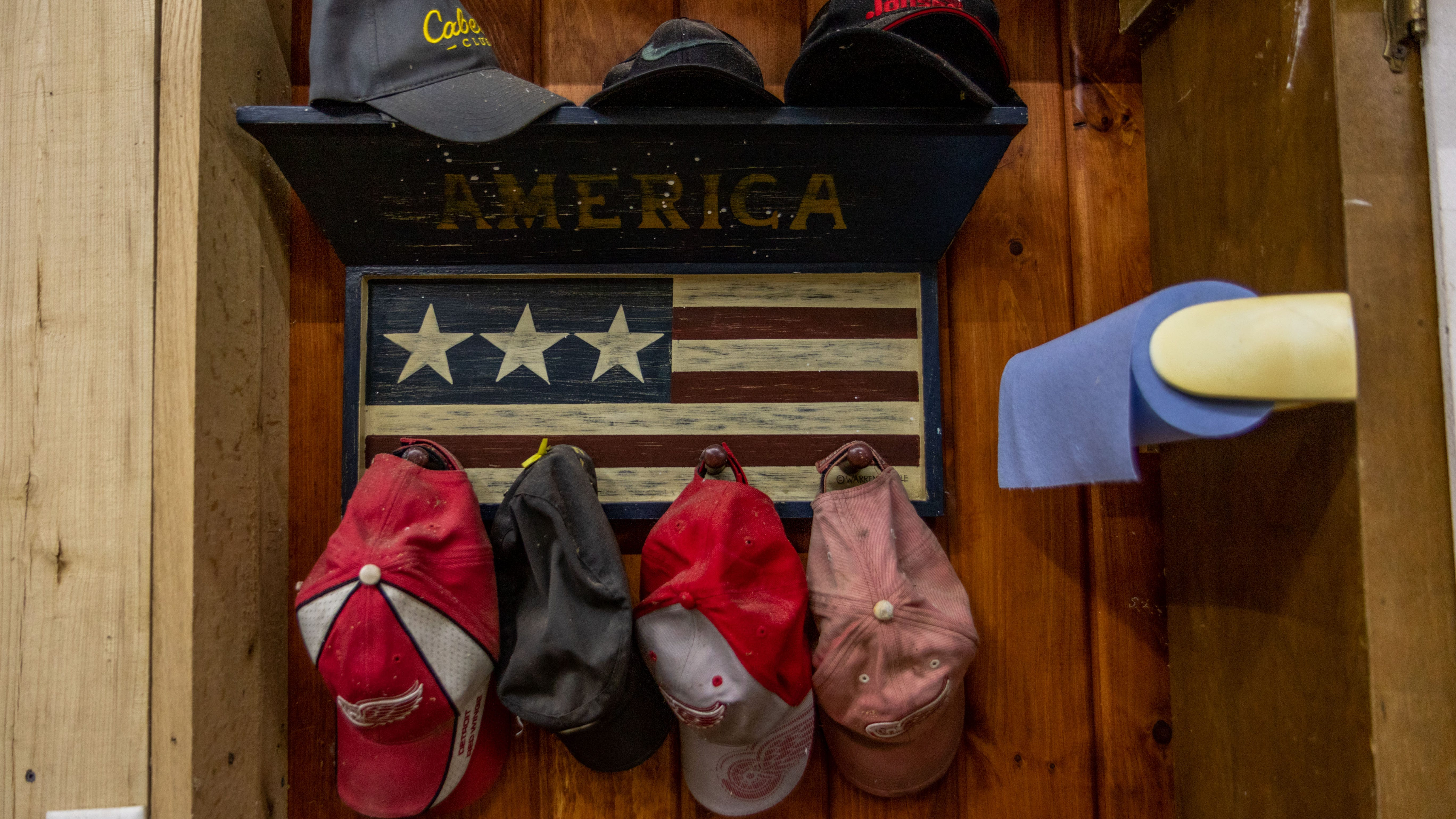 Gerald Keen, a Detroit Red Wings fan, keeps a collection of Red Wings hats, posters and other memorabilia in his shop. The Keen's are on a mission to help Gerald's former Afghan interpreter get a special visa to come to the U.S. before American forces withdraw from Afghanistan by Sept. 11.