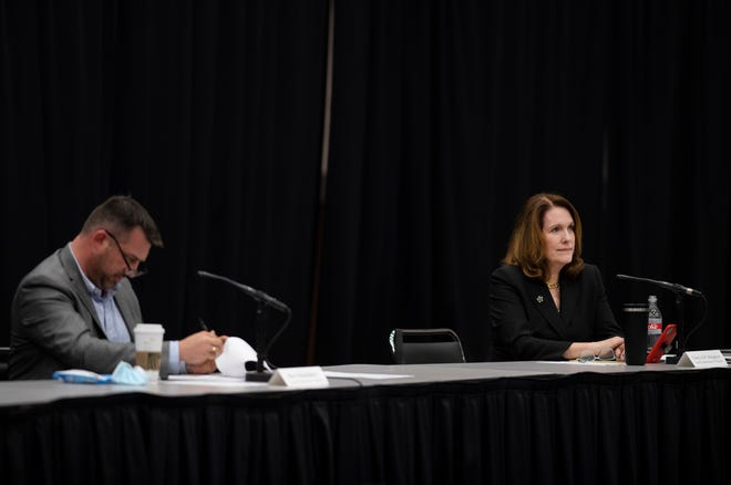 Vanderburgh County Commissioners Ben Shoulders, left, and Cheryl Musgrave attend the commissioners meeting at Old National Events Plaza Tuesday afternoon, May 25, 2021.