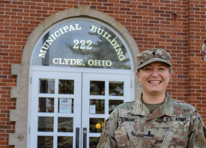 1st Lt. Chelsea Zerman stands if front of Clyde's municipal building, which houses the office of city manager Paul Fiser. Fiser was one of the many locals who helped Zerman through the application process at West Point.