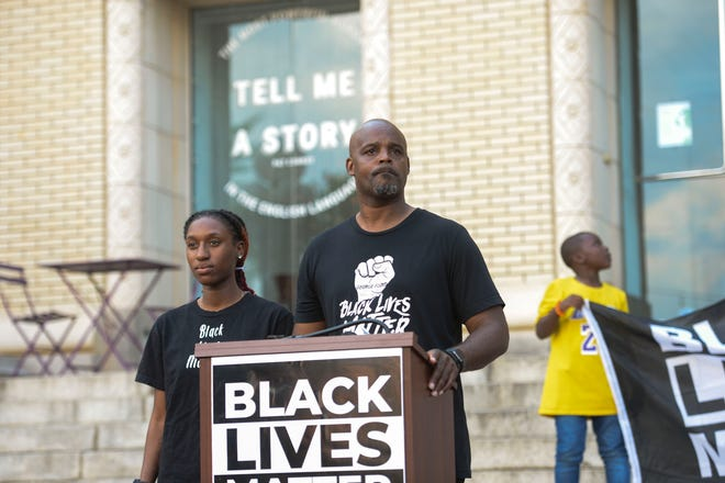 Activist Bruce Wilson addresses a crowd at a Black Lives Matter rally outside of Sen. Lindsey Graham's office in Greenville, SC on May 25, 2021.