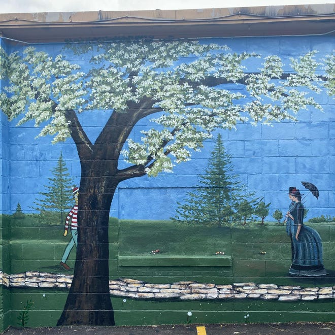 """This mural is on the side of Krueger's, a bowling venue, restaurant and arcade at N87 W16471 Appleton Ave. It is downtown Menomonee Falls' newest mural and is titled """"Timeless Walk in the Park."""""""