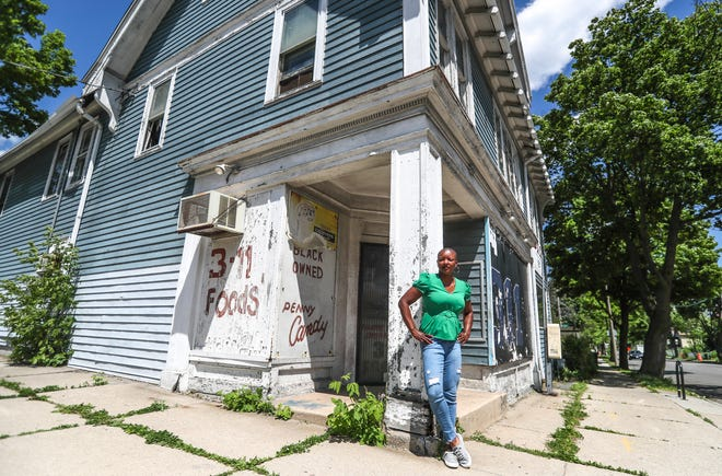 Tonda Thompson purchased this dilapidated building at 128 E. Burleigh St. in Milwaukee for $3,000. It will cost her $361,000 to renovate. It is a three-story building where the first floor will be for Valor Creative Collective, which will house She Slangs Wood. The second floor will be National Coalition for Healthy Black Families, which organizes the HaRUNbee 5K walk/run for healthy birth outcomes. The third floor will be for Vogue Dreams Productions,  which is a videography/photography production studio.