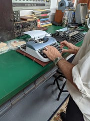 Tom Hanks tries out another manual typewriter at a Goodlettsville shop owned by Kirk Jackson May 25, 2021