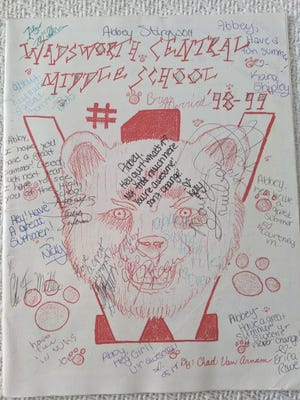 Abbey Roy's middle school yearbook, where many classmates wished for her to have a great summer.