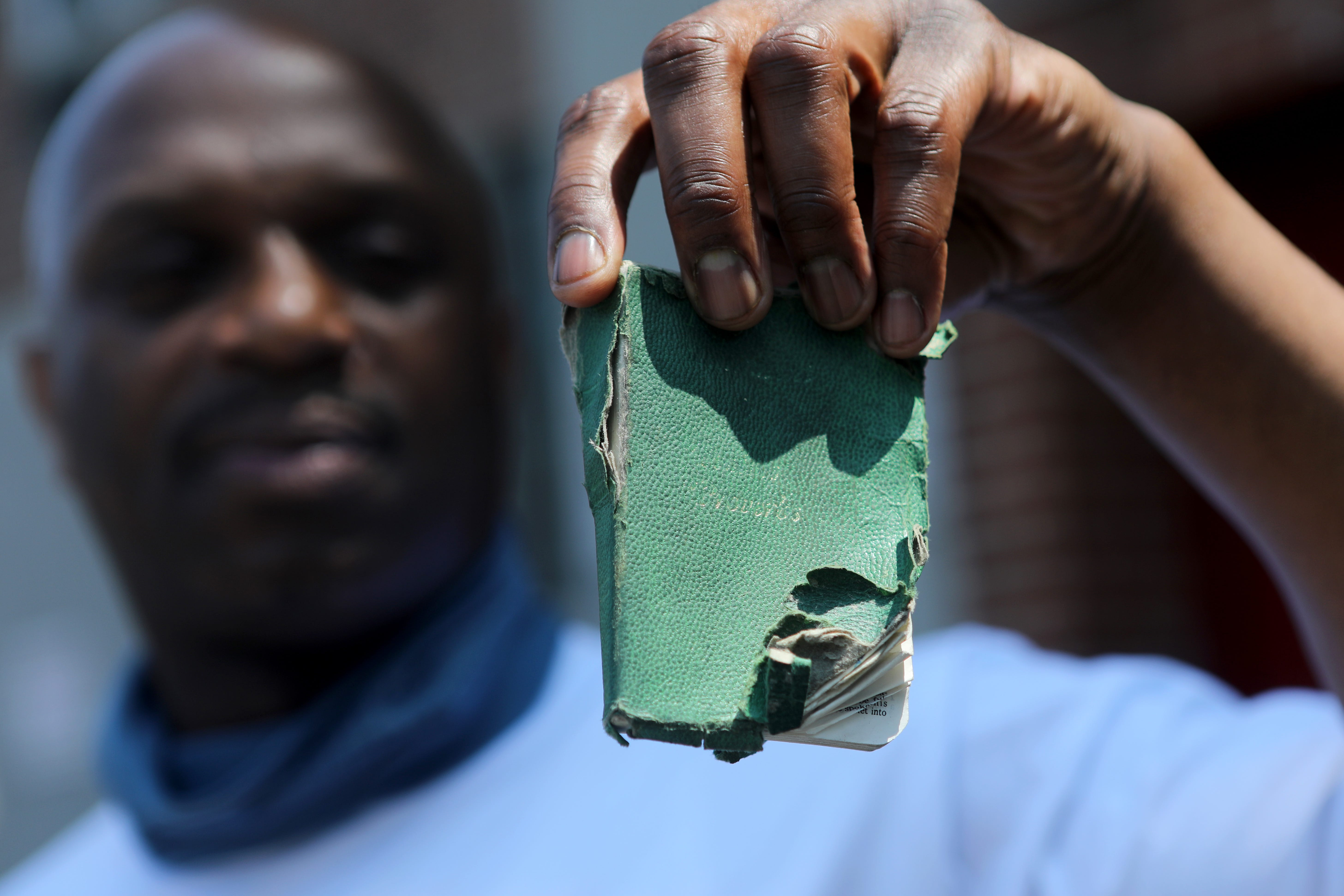 Jarmaine Grant holds the Bible he had with him when he was shot by New Jersey State Police in 1998 on the shoulder of the NJ Turnpike.