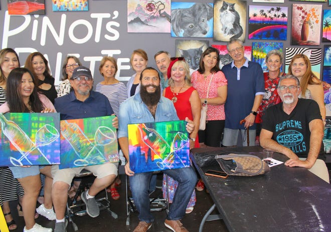 Kiwanis members and volunteers pose with professional artist Toufic Louka (front, center) at Pinot's Palette on May 22, 2021.