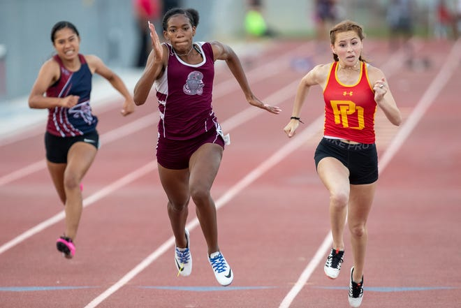 Dalyse Matthews, right, wins the 100 meter dash as Trinity Barnett of Rancho Mirage finishes second during the Desert Empire League Track and Field Finals in Palm Desert, Calif., on May 25, 2021.