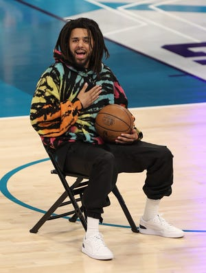Feb 16, 2019; Charlotte, NC, USA; Recording artist J Cole during the AT&T Slam Dunk Contest at the NBA All-Star Saturday Night at Spectrum Center. Mandatory Credit: Jim Dedmon-USA TODAY Sports