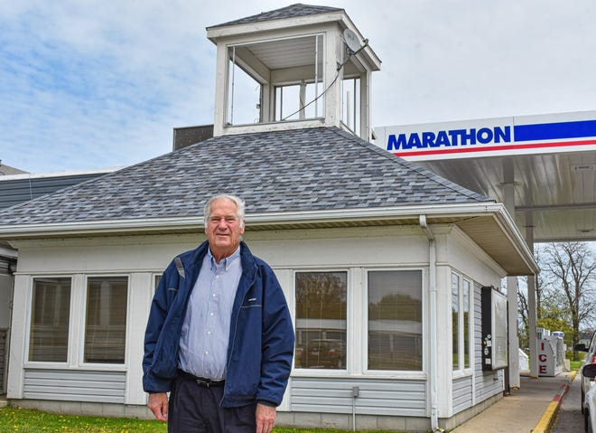 Dennis Felton stands next to the Wild Wings Restaurant and Lounge where a new Biggby Coffee will soon open. The coffee shop will be a convenient addition to Felton's other businesses, which include a marina, a campground, and a gas station.